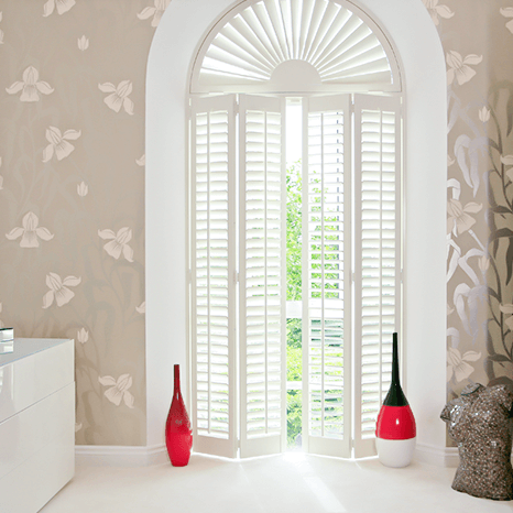 White Wooden Shutters fitted on a large door window
