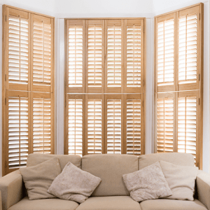 Wooden Shutter for large window with a classic shape and light brown colour
