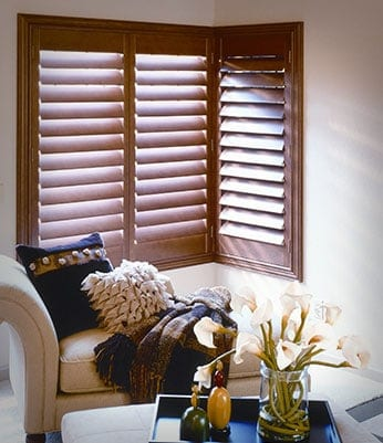 Wooden plantation shutters in natural wood colour
