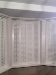 Closed White Shutters in Whitley Bay