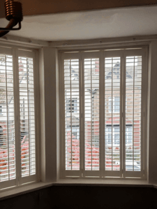 Open White Shutters in Whitley Bay
