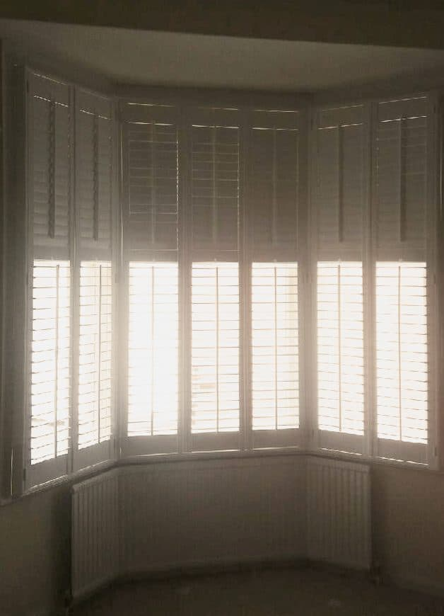 After the installation of white large window shutters Gosforth