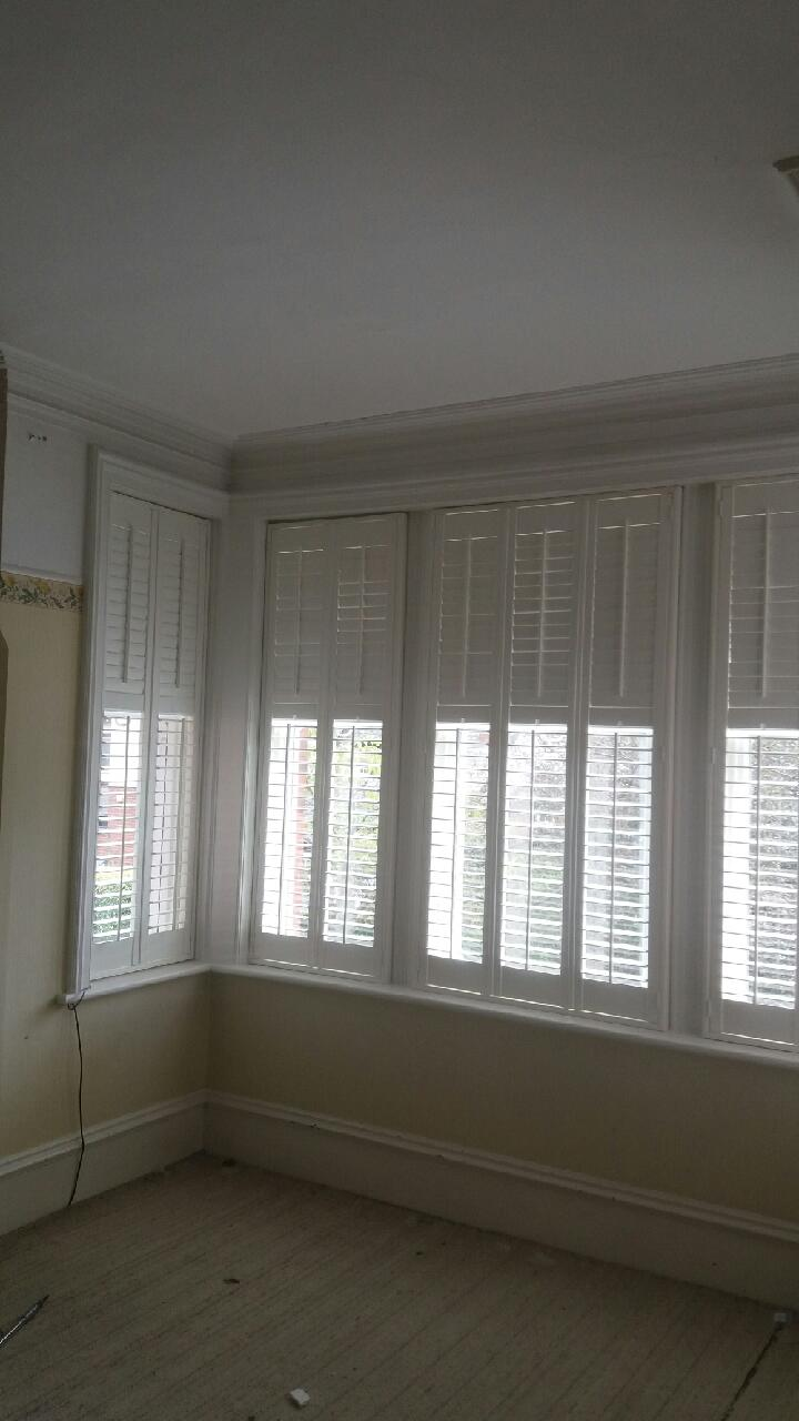 After the installation large white window shutters Gosforth