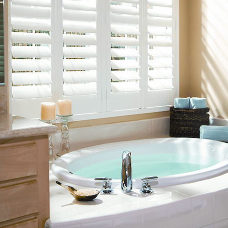 White Wooden Shutters in Yorkshire fitted on a large bathroom window
