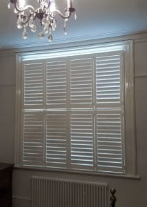 Picture of window tier-on-tier shutters in white installed in Gosforth