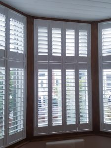 tier-on-tier wooden blinds south shields bay window inside after