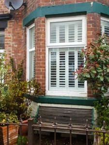tier-on-tier large solid plantation shutters south shields bay window outside after