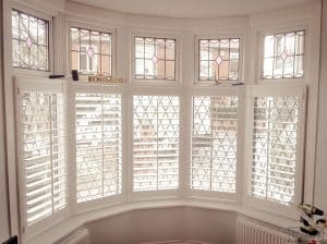 plantation shutters York - bay window shutters after expert installation