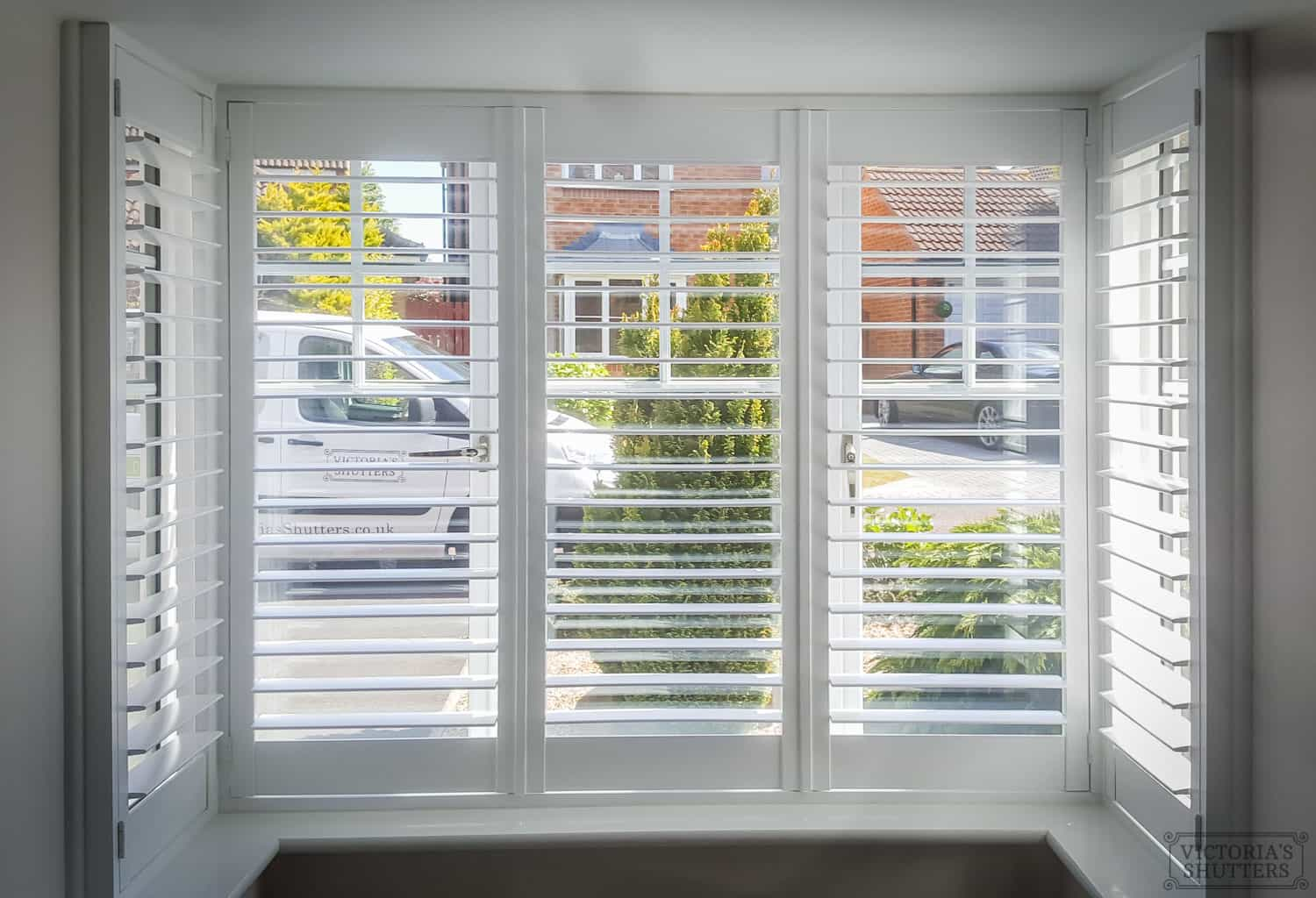 inside picture of white wooden bay window shutters in York