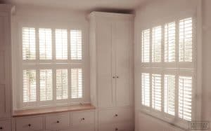 living room window shutters - white wood colour by Plantation Shutters York