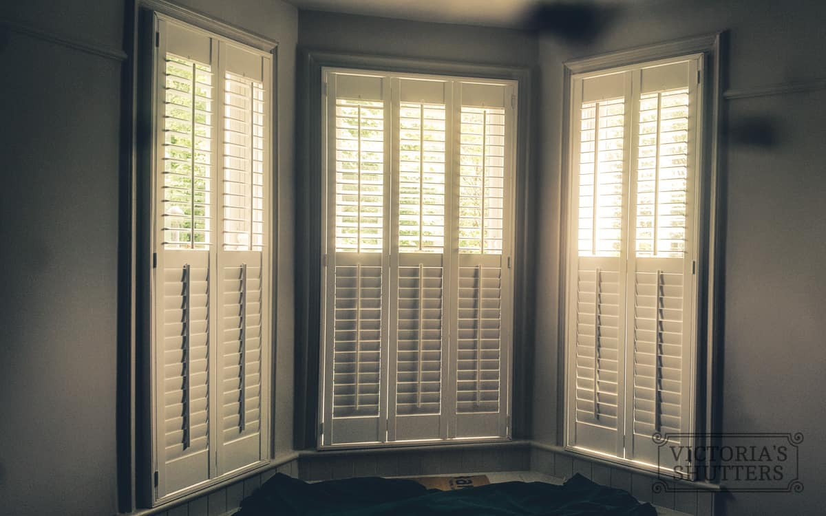 tier-on-tier white large window shutter closed made by plantation shutters Leeds branch