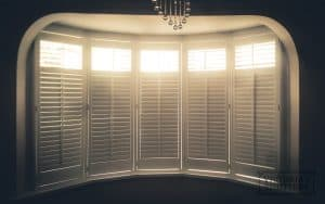 large window plantation shutters in white for customer in Leeds