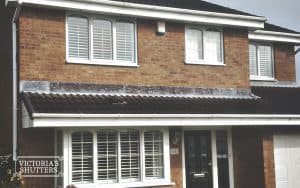 Facade of a home with white plantation shutters in Newcastle, UK