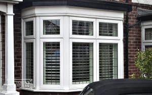 Plantation shutters in winter in Tyne and Wear. View from outside.