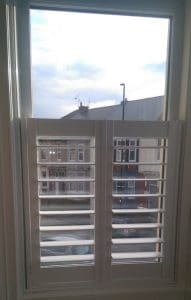small kitchen shutters by plantation shutters Leeds fitted for customer