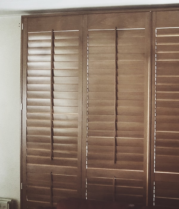 Natural wood finish plantation shutters