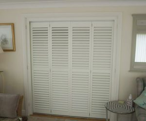 Large tracked plantation shutters