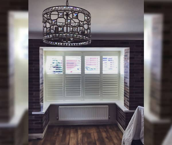 Partially open bi-fold plantation shutters