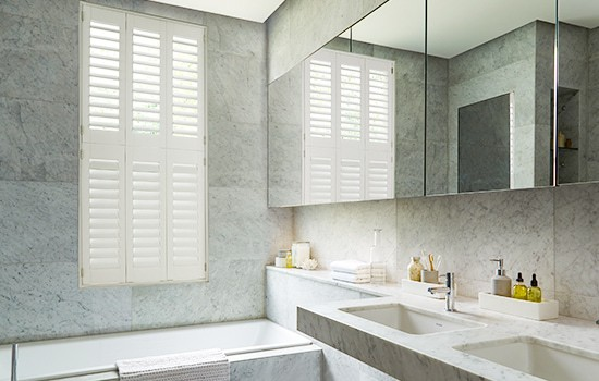 White bathroom plantation shutters